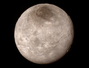 Surface of Charon appears youthful without craters and includes a canyon about 4 to 6 miles deep.